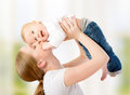 Happy Family. Mother Throws Up Baby, Playing Stock Images - 30732824