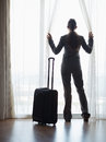 Silhouette Of Business Woman With Wheel Bag Royalty Free Stock Photos - 30780948