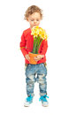Toddler Boy Smelling Flowers Stock Photography - 30791232