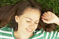 Girl Lies On Grass Royalty Free Stock Photo - 3080505