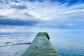 Concrete Pier Or Jetty On A Blue Sea And Cloudy Sky. Normandy, France Royalty Free Stock Images - 30826949