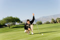 Male Golfer Lining Up Putt Stock Photography - 30841702