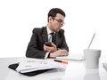 Young Executive Man Working On Laptop Computer And Holding A Sma Royalty Free Stock Photo - 30872005