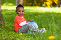 Outdoor Portrait Of A Cute Young  Little Black Boy Playing With Stock Images - 30878984