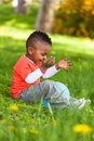 Outdoor Portrait Of A Cute Young  Little Black Boy Playing With Royalty Free Stock Images - 30879099