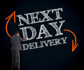 Businessman On Ladder Writing Next Day Delivery Stock Photo - 30887270