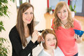Hairdresser Dying Hair Of Client Stock Image - 30888821