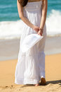 Woman Walking On Beach Stock Images - 30893114
