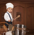 Boy In A Cook Cap Among Pans And Vegetables Stock Images - 30910904