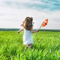 Girl With A Windmill In Hand Stock Image - 30924101