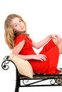 Child With Red Dress On Bench Royalty Free Stock Photos - 30971798