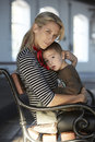 Beautiful Blonde Woman And Her Little Son Together Royalty Free Stock Image - 30979716