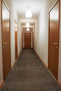 Empty Corridor With Wooden Doors Royalty Free Stock Photo - 30996845