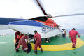 The Helicopter Landing Officer Are Loading Baggage And Passenger Stock Images - 30999764