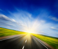 Motion Blurred Road In Blooming Spring Meadow Stock Photography - 31004002