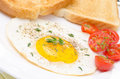 Fried Eggs, Fresh Tomatoes And Crunchy Toast For Breakfast Stock Photo - 31027450