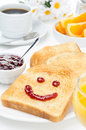 Toast With A Smile Of Jam, Coffee, Orange Juice And Fresh Orange Stock Photography - 31027652