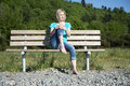 Woman On Bench Stock Photography - 31037202