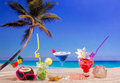 Beach Tropical Cocktails On White Sand Mojito Blue Hawaii Stock Photos - 31037753