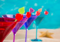 Colorful Cocktail In A Row With Cherry On Tropical Sand Beach Royalty Free Stock Photos - 31037828