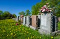 Aligned Headstones In A Cemetary Royalty Free Stock Photo - 31051055