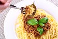 Properly Eat Spaghetti Bolognese With Fork And Spoon Royalty Free Stock Photo - 31051505