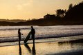 Couple Of Surfers In Tofino Beach At Sunset Royalty Free Stock Images - 31054539