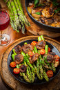 Roasted Mushrooms With Green Asparagus Royalty Free Stock Photo - 31067515