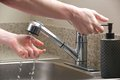 Hands Reach For Soap At The Kitchen Sink Royalty Free Stock Photo - 31092105