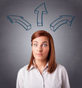 Pretty Lady Thinking With Arrows Overhead Stock Photography - 31147462