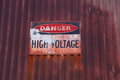 Old Voltage Warning Sign Royalty Free Stock Photo - 31166335