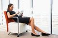 Businesswoman Relaxing With Digital Tablet Royalty Free Stock Photo - 31172275