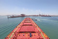 Into The Chinese Port Of Qingdao Ore Carriers Royalty Free Stock Photography - 31181267