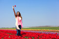 Woman In Red Tulip Field Stock Photography - 31184902