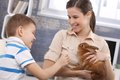 Smiling Mum And Little Son With Pet Rabbit Royalty Free Stock Photos - 31218918