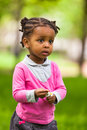 Outdoor Close Up Portrait Of A Cute Little Young Black Girl Stock Photos - 31226273