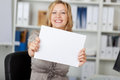 Smiling Businesswoman Holding Blank Paper Stock Photos - 31228423