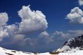 Blue Sky With Clouds In Snow Mountains Stock Images - 31244804