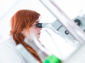 Student Under Microscope Analysis Royalty Free Stock Images - 31257989