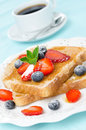 Toast With Honey, Fresh Strawberries And Blueberries Royalty Free Stock Photography - 31262207
