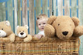 Toddler With Teddy Bears Standing In A Trunk Stock Photo - 31266930