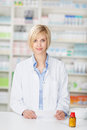 Pharmacist With Pill Bottle And Prescription Paper Stock Images - 31272864