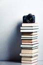 Camera On A High Stack Of Books Stock Photography - 31276992