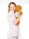 Girl Hugging A Teddy Bear Royalty Free Stock Photography - 31285807