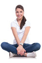 Casual Woman Holds Crossed  Legs Stock Photos - 31289063