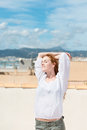 Woman Enjoying The Sun Above The Town Royalty Free Stock Image - 31308746
