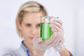 Confident Scientist Experimenting With Green Liquid Royalty Free Stock Images - 31351219