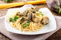 Spaghetti With Artichokes And Parsley Stock Photos - 31424143