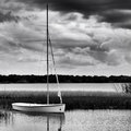 Sailboat Anchored On Lake During Stormy Day Royalty Free Stock Photography - 31433017
