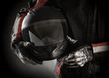 Motorcyclist With Helmet In His Hands. Dark Background Royalty Free Stock Photo - 31446685